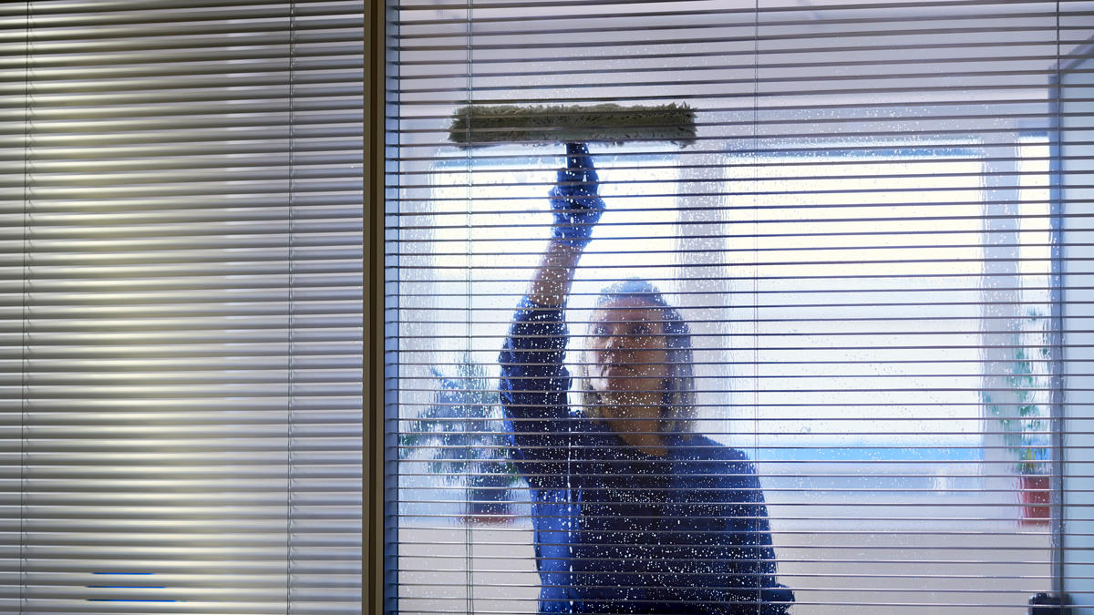 professional-maid-cleaning-and-wiping-window-in-of-PGNTVGH